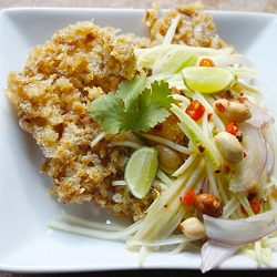 sweet, spicy green mango salad on a bed of crispy, airy nest of fish ...